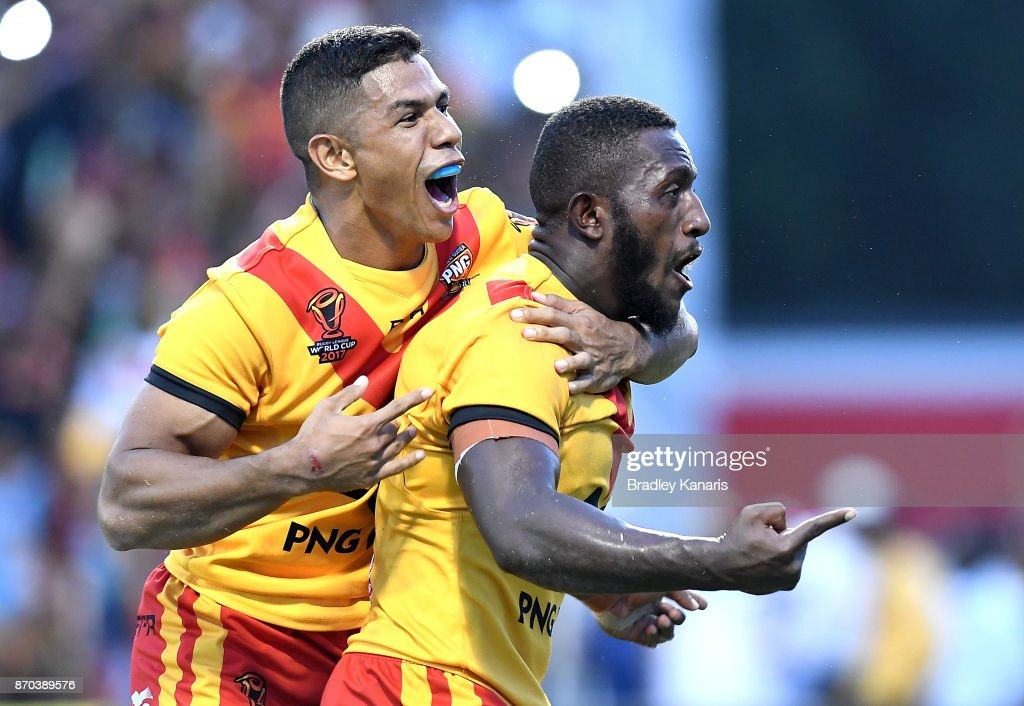 Watson Boas of Papua New Guinea celebrates with team mate David Mead after scoring the match winning try during the 2017 Rugby League World Cup match between Papua New Guinea Kumuls and Ireland on November 5, 2017 in Port Moresby, Papua New Guinea.