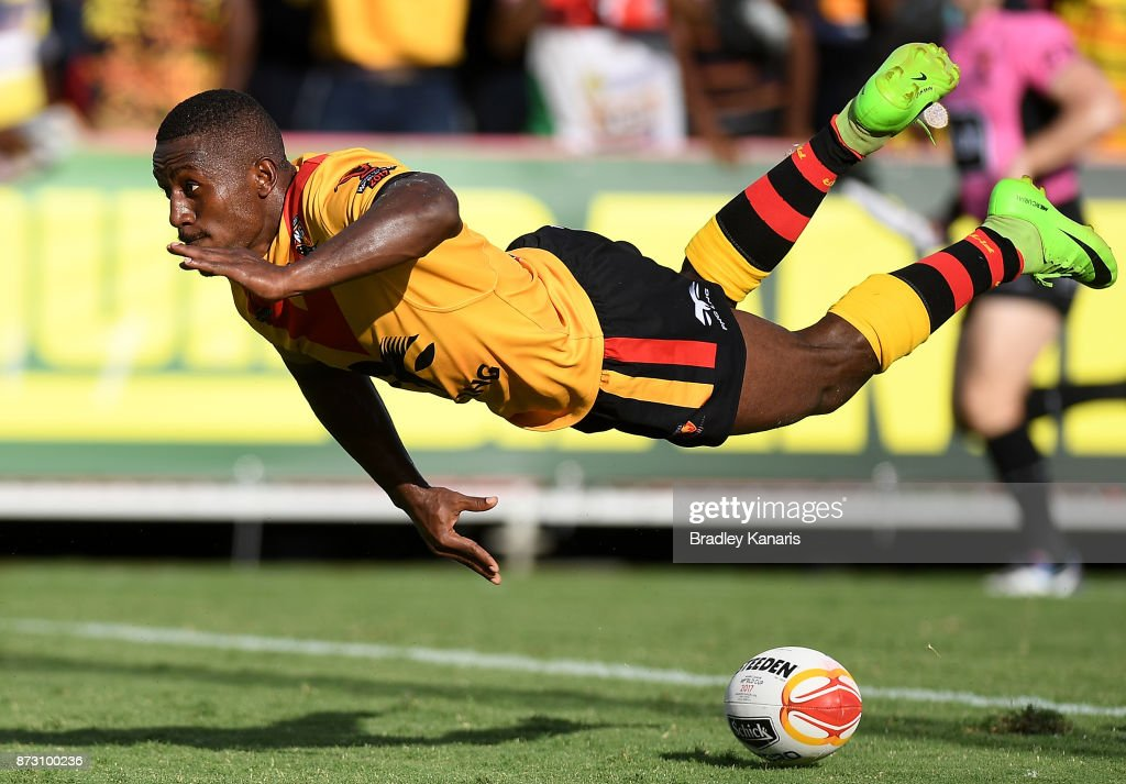 Watson Boas of Papua New Guinea scores a try during the 2017 Rugby League World Cup match between Papua New Guinea and the United States on November 12, 2017 in Port Moresby, Papua New Guinea.