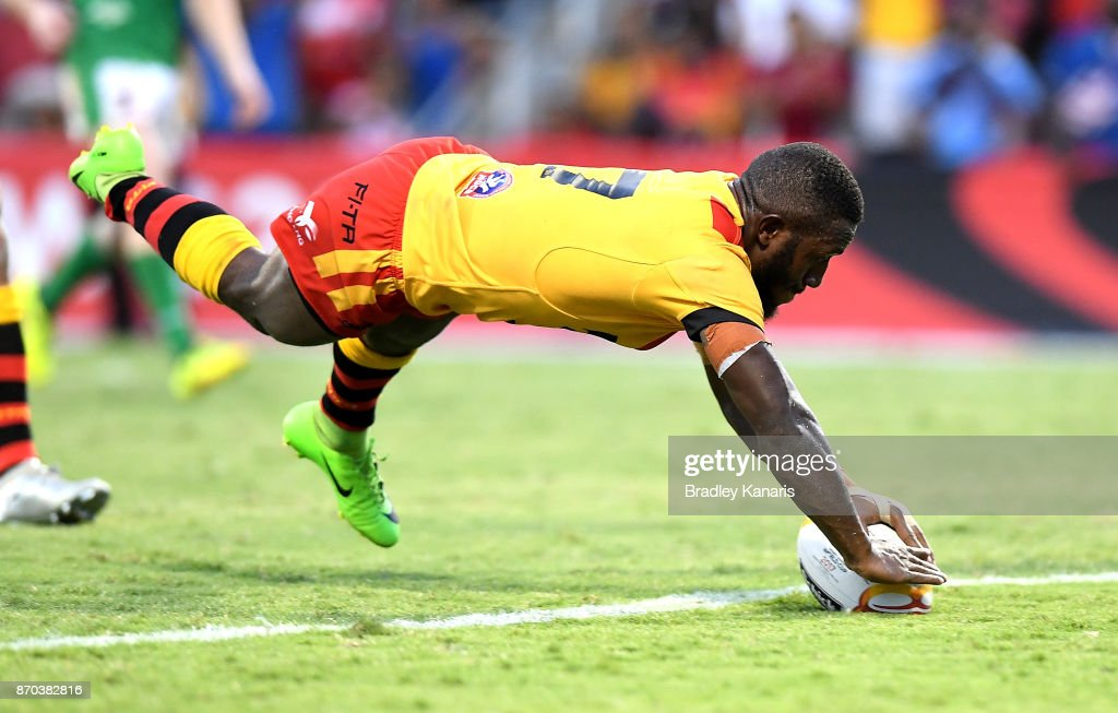 Watson Boas of Papua New Guinea scores the match winning try during the 2017 Rugby League World Cup match between Papua New Guinea Kumuls and Ireland on November 5, 2017 in Port Moresby, Papua New Guinea.