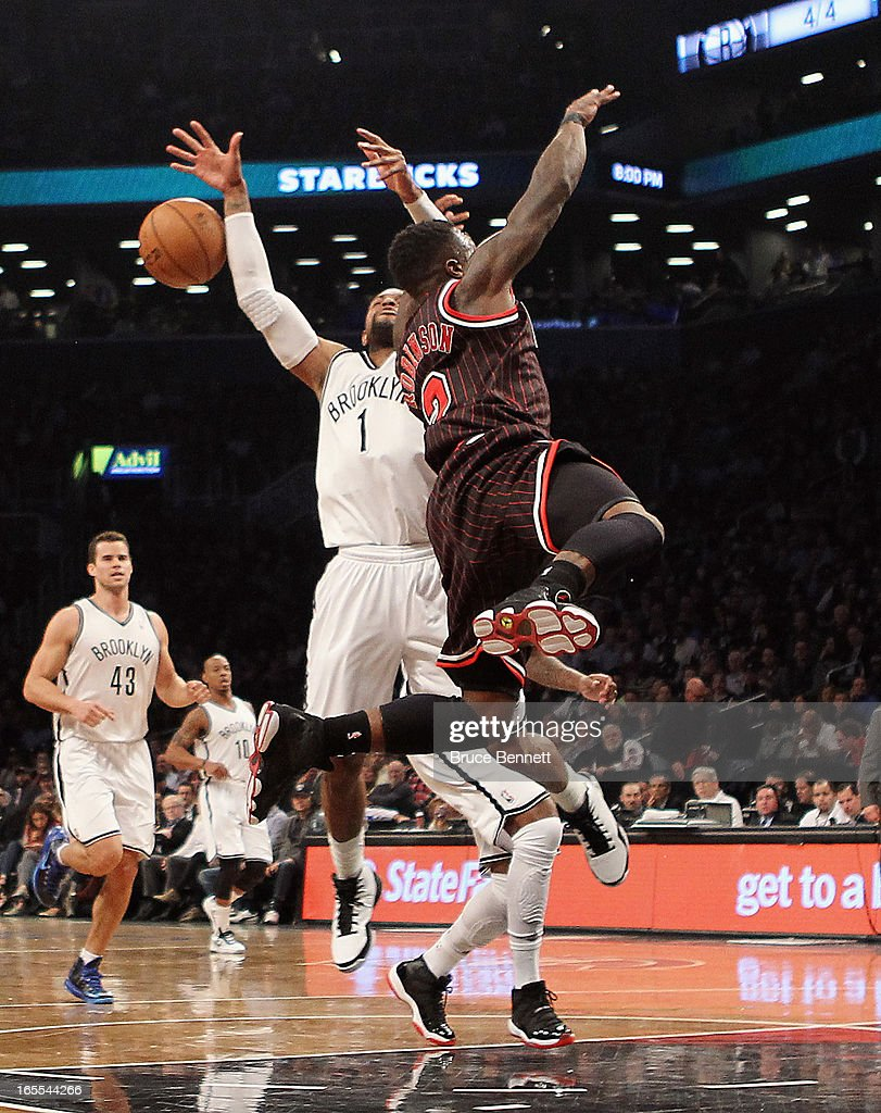 J Watson of the Brooklyn Nets and Nate Robinson of the Chicago Bulls collide at the Barclays Center on April 4 2013 in New York City NOTE TO USER...