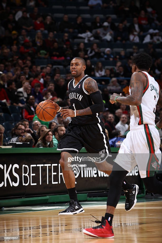 C.J. Watson #1 of the Brooklyn Nets brings the ball up court against the Milwaukee Bucks on December 26, 2012 at the BMO Harris Bradley Center in Milwaukee, Wisconsin.