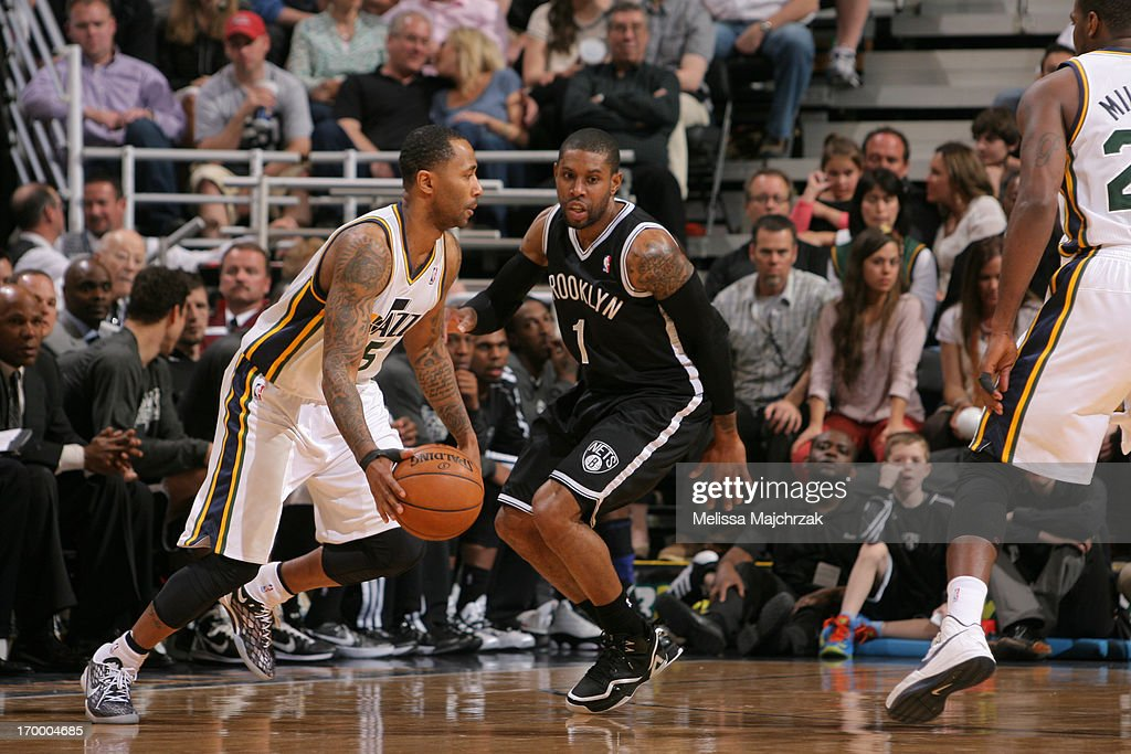 <a gi-track='captionPersonalityLinkClicked' href=/galleries/search?phrase=C.J.+Watson&family=editorial&specificpeople=740190 ng-click='$event.stopPropagation()'>C.J. Watson</a> #1 of the Brooklyn Nets defends against Mo Williams #5 of the Utah Jazz at Energy Solutions Arena on March 30, 2013 in Salt Lake City, Utah.