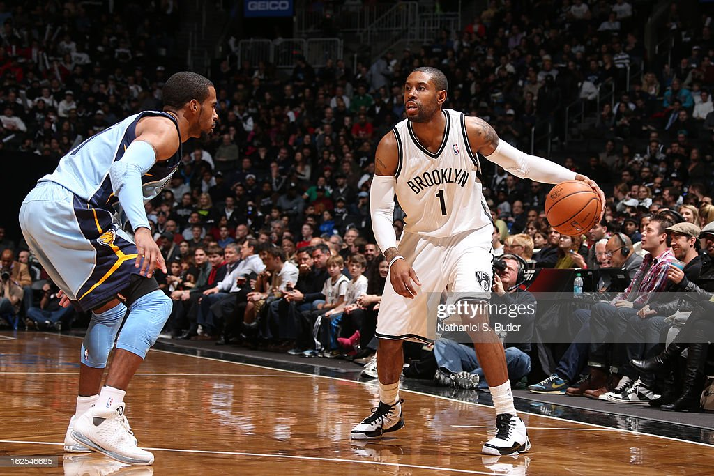 C.J. Watson #1 of the Brooklyn Nets dribbles against Mike Conley #11 of the Memphis Grizzlies on February 24, 2013 at the Barclays Center in the Brooklyn borough of New York City.