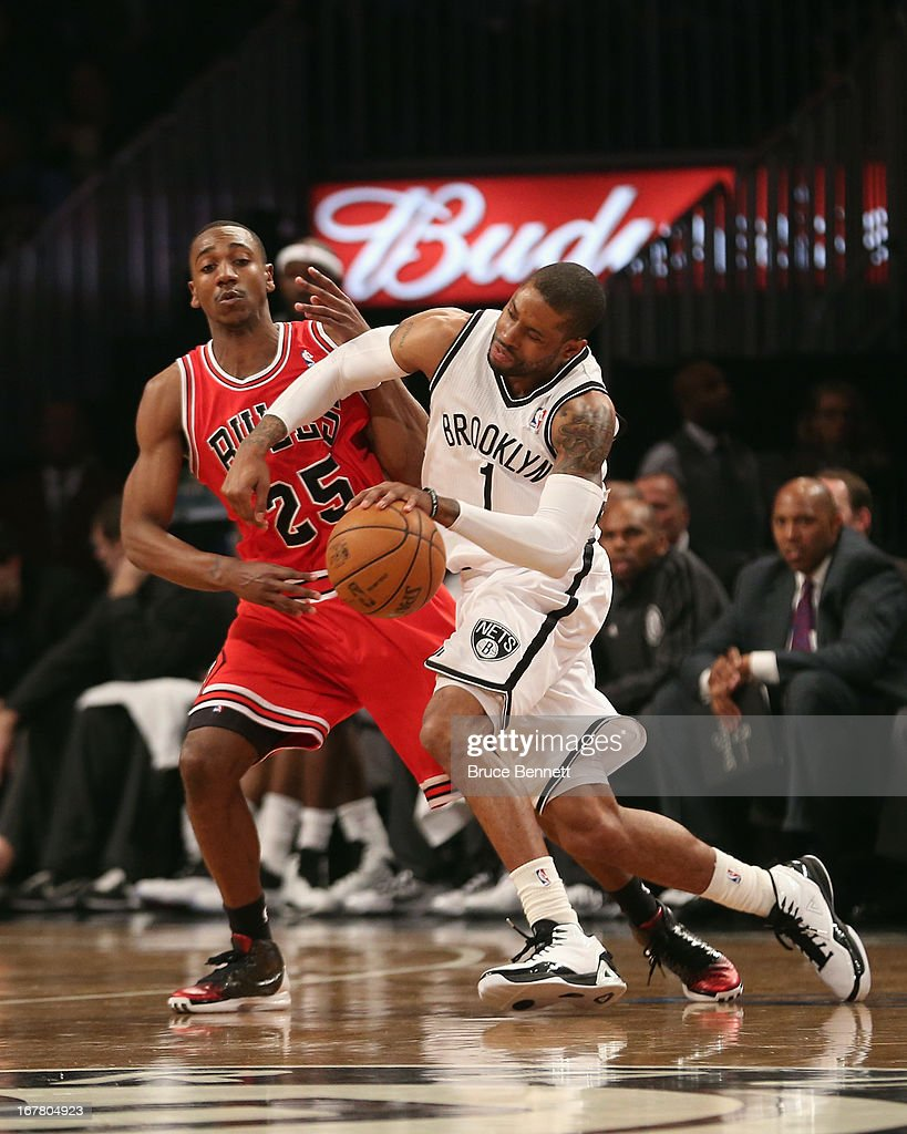 C.J. Watson #1 of the Brooklyn Nets dribbles the ball against the Chicago Bulls during Game Five of the Eastern Conference Quarterfinals of the 2013 NBA Playoffs at the Barclays Center on April 29, 2013 in New York City.