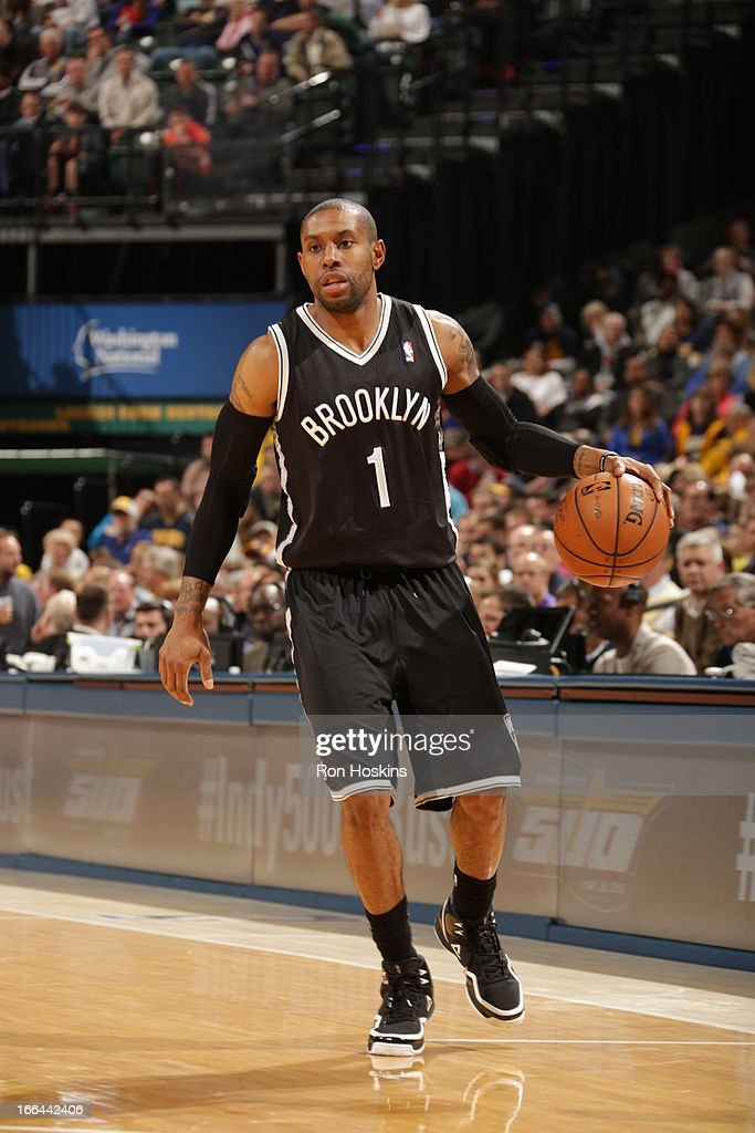 <a gi-track='captionPersonalityLinkClicked' href=/galleries/search?phrase=C.J.+Watson&family=editorial&specificpeople=740190 ng-click='$event.stopPropagation()'>C.J. Watson</a> #1 of the Brooklyn Nets dribbles the ball against the Indiana Pacers on April 12, 2013 at Bankers Life Fieldhouse in Indianapolis, Indiana.