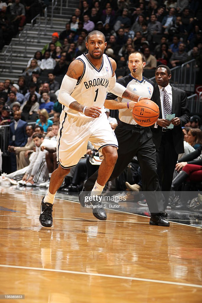 <a gi-track='captionPersonalityLinkClicked' href=/galleries/search?phrase=C.J.+Watson&family=editorial&specificpeople=740190 ng-click='$event.stopPropagation()'>C.J. Watson</a> #1 of the Brooklyn Nets dribbles the ball upcourt against the Cleveland Cavaliers on November 13, 2012 at the Barclays Center in the Brooklyn Borough of New York City.