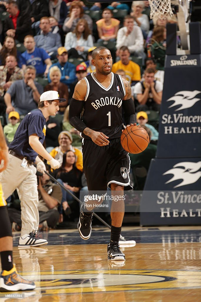 <a gi-track='captionPersonalityLinkClicked' href=/galleries/search?phrase=C.J.+Watson&family=editorial&specificpeople=740190 ng-click='$event.stopPropagation()'>C.J. Watson</a> #1 of the Brooklyn Nets dribbles up the court against the Indiana Pacers on April 12, 2013 at Bankers Life Fieldhouse in Indianapolis, Indiana.