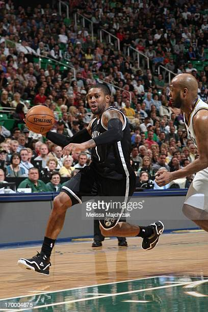 J Watson of the Brooklyn Nets drives to the basket against Jamaal Tinsley of the Utah Jazz at Energy Solutions Arena on March 30 2013 in Salt Lake...