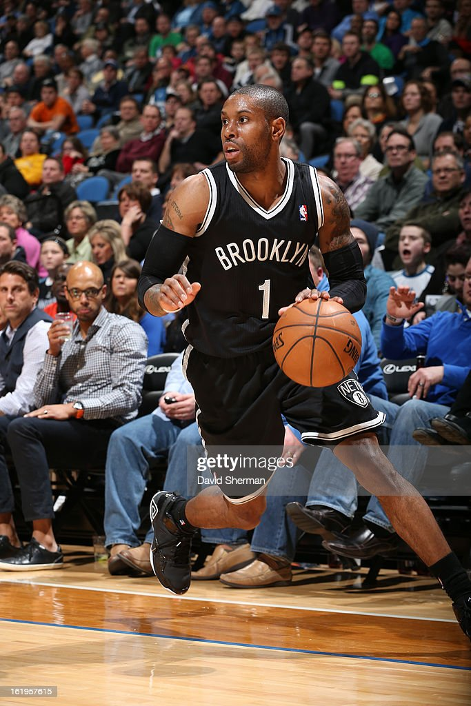 <a gi-track='captionPersonalityLinkClicked' href=/galleries/search?phrase=C.J.+Watson&family=editorial&specificpeople=740190 ng-click='$event.stopPropagation()'>C.J. Watson</a> #1 of the Brooklyn Nets drives to the basket against the Minnesota Timberwolves on January 23, 2013 at Target Center in Minneapolis, Minnesota.