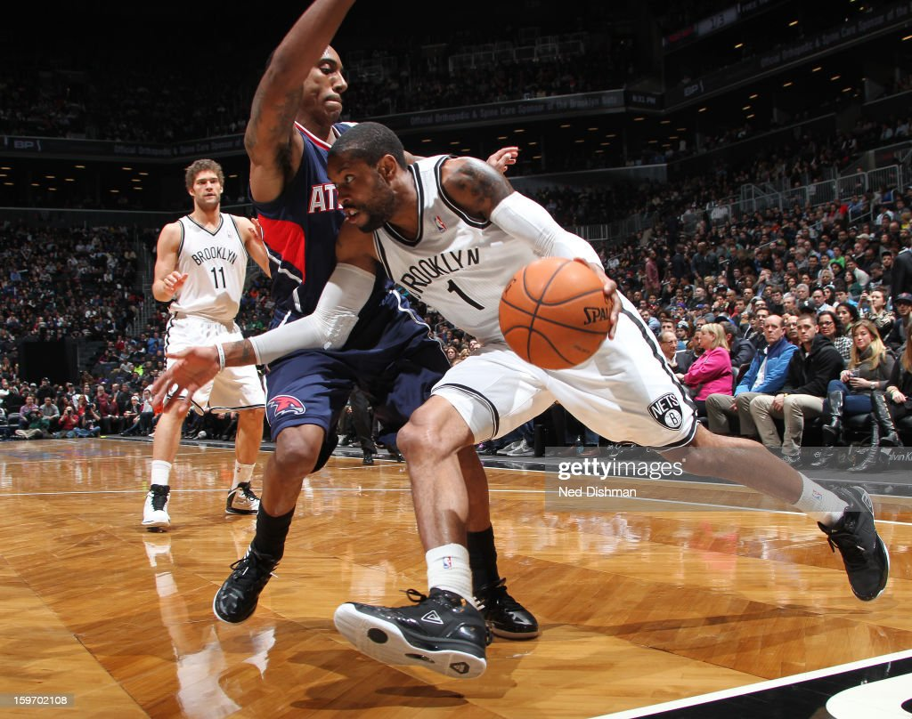 C.J. Watson #1 of the Brooklyn Nets drives to the hoop against the Atlanta Hawks at the Barclays Center on January 18, 2013 in the Brooklyn borough of New York City in New York City.