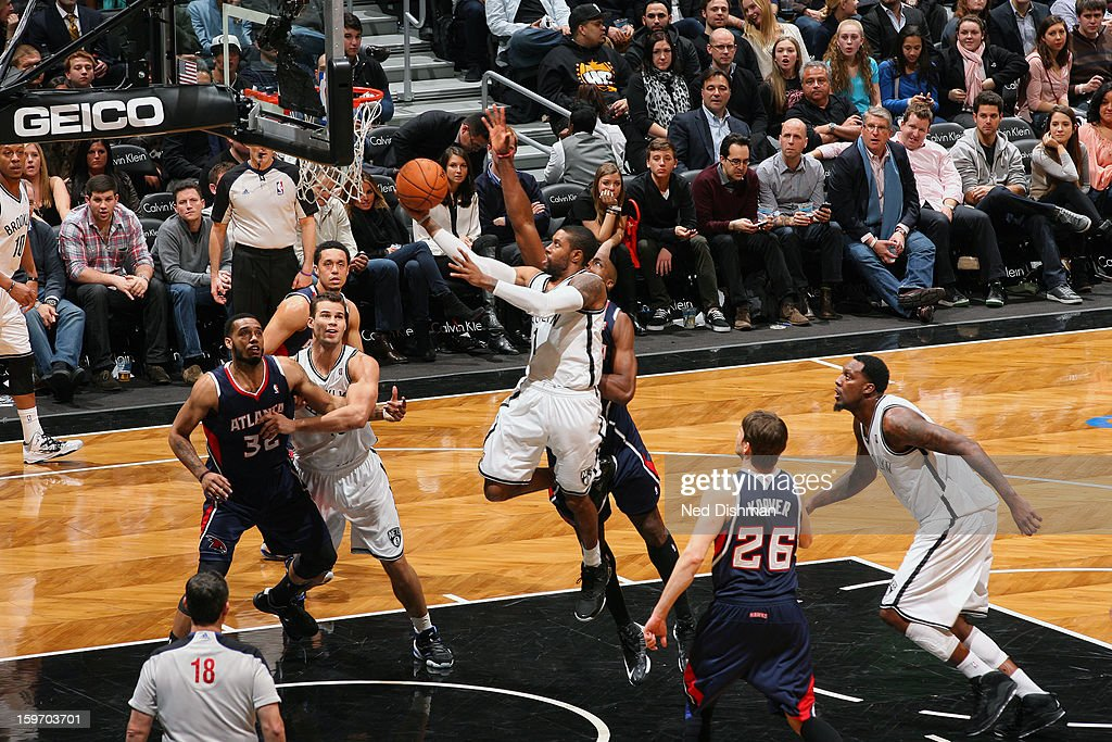 C.J. Watson #1 of the Brooklyn Nets glides to the hoop against the Atlanta Hawks at the Barclays Center on January 18, 2013 in the Brooklyn borough of New York City in New York City.