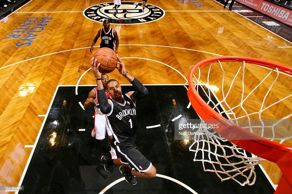 <a gi-track='captionPersonalityLinkClicked' href=/galleries/search?phrase=C.J.+Watson&family=editorial&specificpeople=740190 ng-click='$event.stopPropagation()'>C.J. Watson</a> #1 of the Brooklyn Nets goes to the basket against the Washington Wizards at the Barclays Center on October 15, 2012 in the Brooklyn borough of New York City.
