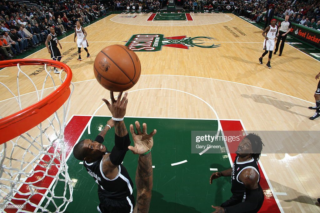 C.J. Watson #1 of the Brooklyn Nets grabs a rebound against the Milwaukee Bucks on December 26, 2012 at the BMO Harris Bradley Center in Milwaukee, Wisconsin.