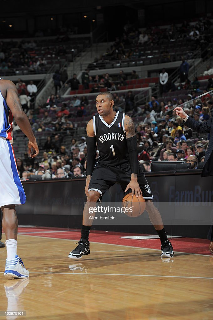 C.J. Watson #1 of the Brooklyn Nets handles the ball against the Detroit Pistons on March 18, 2013 at The Palace of Auburn Hills in Auburn Hills, Michigan.