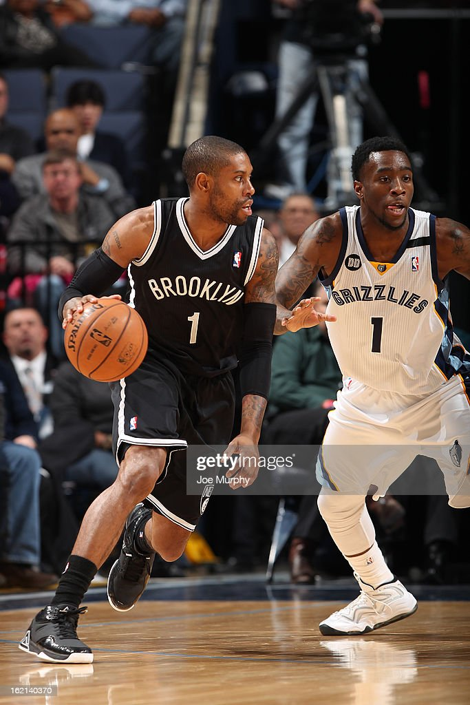 C.J. Watson #1 of the Brooklyn Nets handles the ball against Tony Wroten #1 of the Memphis Grizzlies on January 25, 2013 at FedExForum in Memphis, Tennessee.