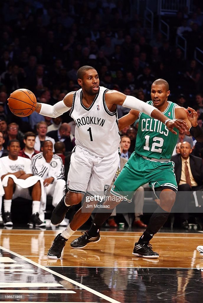C.J. Watson #1 of the Brooklyn Nets in action against Leandro Barbosa #12 of the Boston Celtics at Barclays Center on November 15, 2012 in the Brooklyn borough of New York City.The Nets defeated the Celtics 102-97.