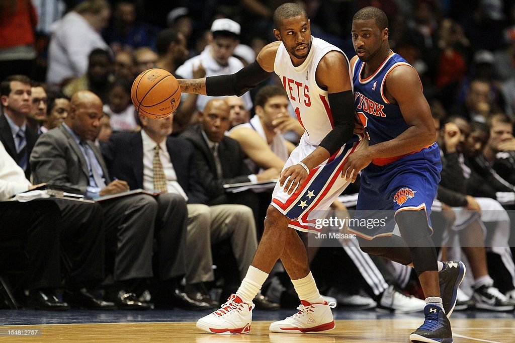 C.J. Watson #1 of the Brooklyn Nets in action against Raymond Felton #2 of the New York Knicks during a preseason game at Nassau Coliseum on October 24 2012 in Uniondale, New York The Knicks defeated the Nets 97-95.