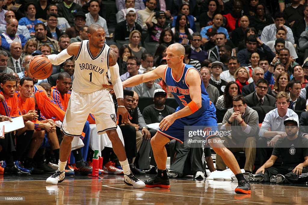C.J. Watson #1 of the Brooklyn Nets looks to pass the ball while guarded by Jason Kidd #5 of the New York Knicks on December 11, 2012 at the Barclays Center in the Brooklyn borough of New York City.