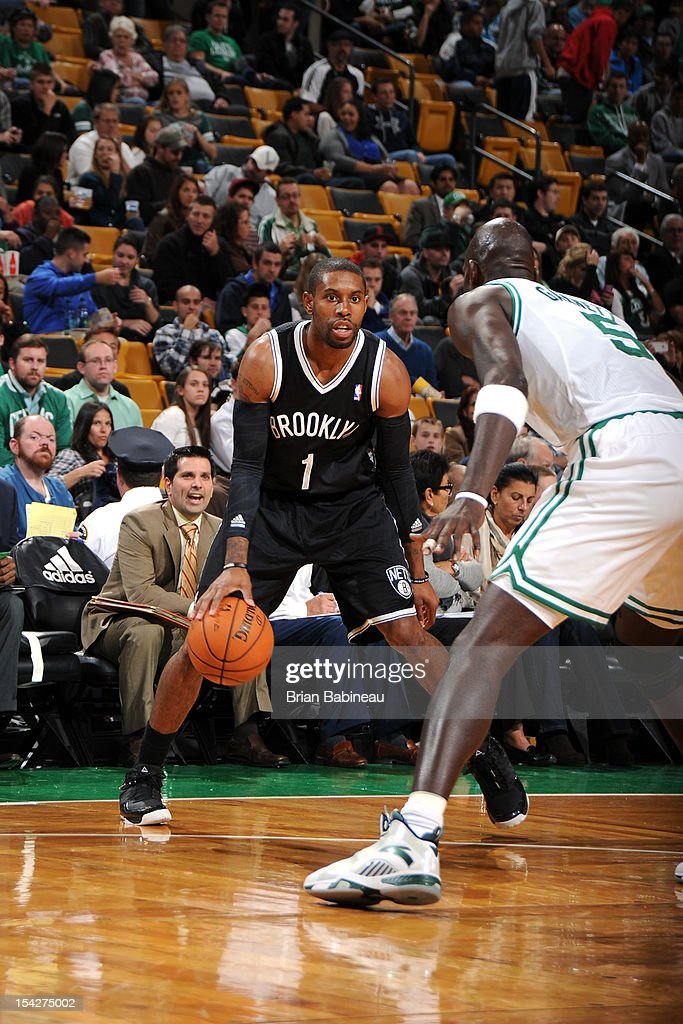 C.J. Watson #1 of the Brooklyn Nets makes a move against the Boston Celtics on October 16, 2012 at the TD Garden in Boston, Massachusetts.