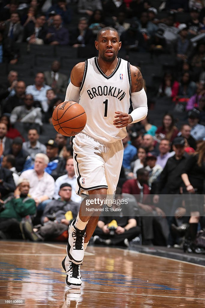 C.J. Watson #1 of the Brooklyn Nets moves the ball up-court against the Washington Wizards on April 15, 2013 at the Barclays Center in the Brooklyn borough of New York City.
