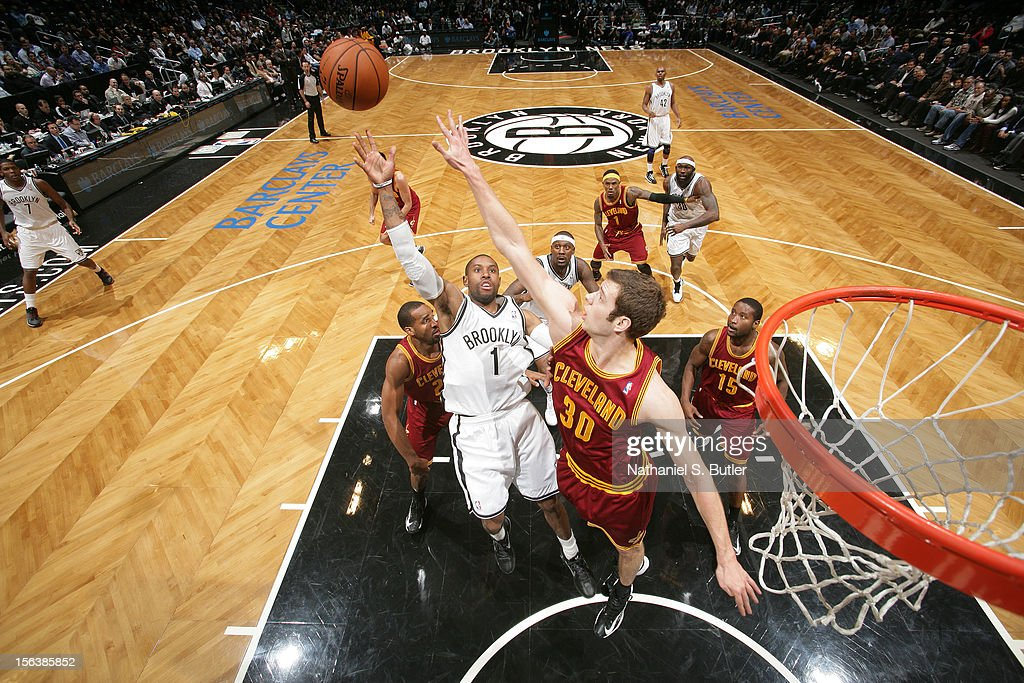 <a gi-track='captionPersonalityLinkClicked' href=/galleries/search?phrase=C.J.+Watson&family=editorial&specificpeople=740190 ng-click='$event.stopPropagation()'>C.J. Watson</a> #1 of the Brooklyn Nets puts up a shot over <a gi-track='captionPersonalityLinkClicked' href=/galleries/search?phrase=Jon+Leuer&family=editorial&specificpeople=4630766 ng-click='$event.stopPropagation()'>Jon Leuer</a> #30 of the Cleveland Cavaliers on November 13, 2012 at the Barclays Center in the Brooklyn Borough of New York City.