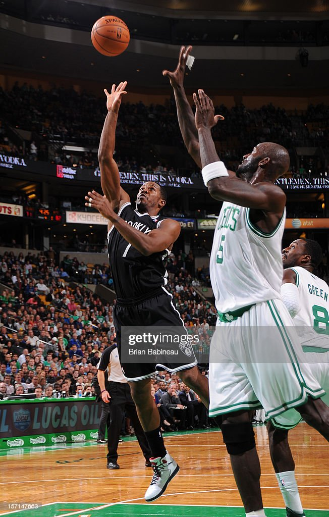 C.J. Watson #1 of the Brooklyn Nets puts up the shot against Kevin Garnett #5 of the Boston Celtics on November 28, 2012 at the TD Garden in Boston, Massachusetts.