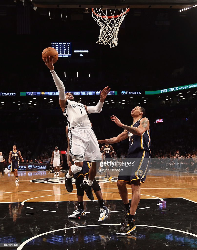 C.J. Watson #1 of the Brooklyn Nets scores two against the Indiana Pacers during the second half at the Barclays Center on January 13, 2013 in New York City.