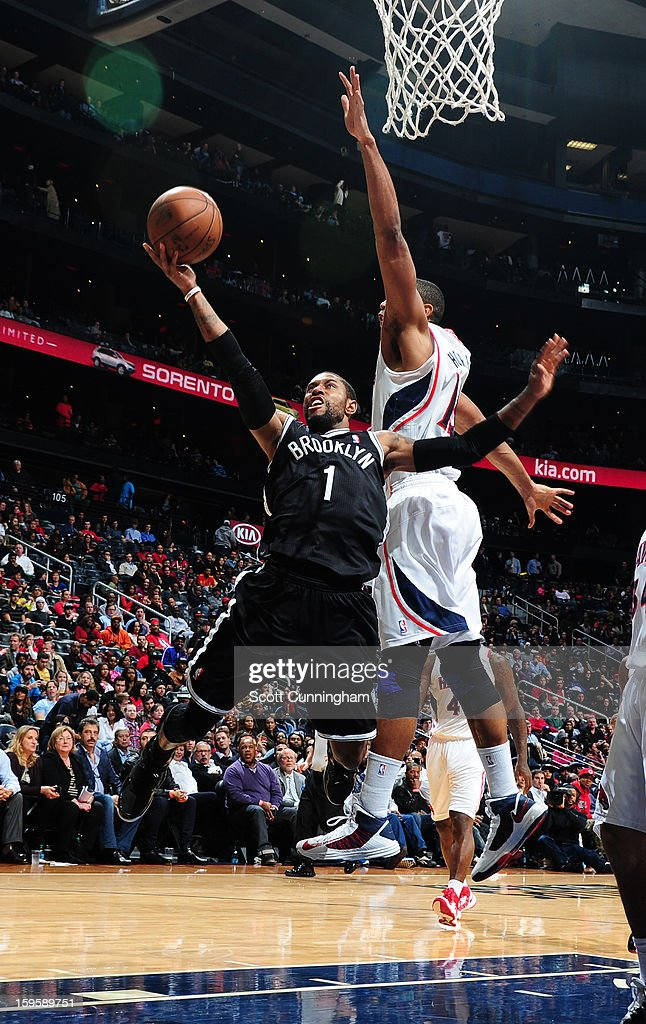 C.J. Watson #1 of the Brooklyn Nets shoots a layup against the Atlanta Hawks on January 16, 2013 at Philips Arena in Atlanta, Georgia.