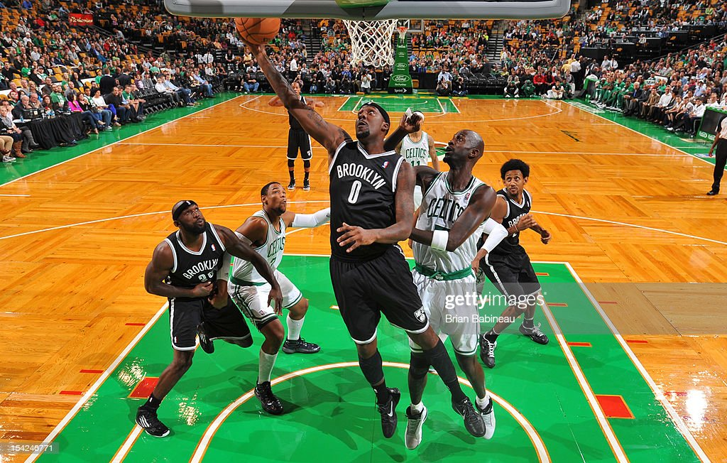 C.J. Watson #0 of the Brooklyn Nets shoots the ball against Kevin Garnett #5 of the Boston Celtics on October 16, 2012 at the TD Garden in Boston, Massachusetts.