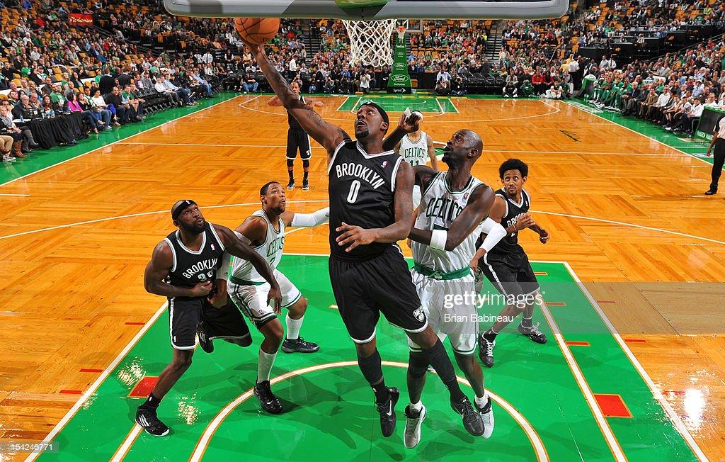 C.J. Watson #0 of the Brooklyn Nets shoots the ball against Kevin Garnett #5 of the Boston Celtics on October 16, 2012 at the TD Garden in Boston, Massachusetts.