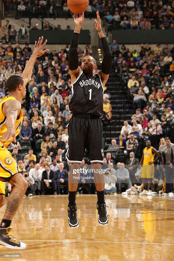 <a gi-track='captionPersonalityLinkClicked' href=/galleries/search?phrase=C.J.+Watson&family=editorial&specificpeople=740190 ng-click='$event.stopPropagation()'>C.J. Watson</a> #1 of the Brooklyn Nets shoots the ball against the Indiana Pacers on April 12, 2013 at Bankers Life Fieldhouse in Indianapolis, Indiana.