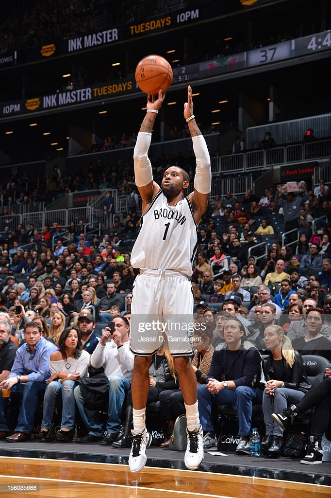 C.J. Watson #1 of the Brooklyn Nets shoots the ball against the Milwaukee Bucks at the Barclays Center on December 9, 2012 in Brooklyn, New York.
