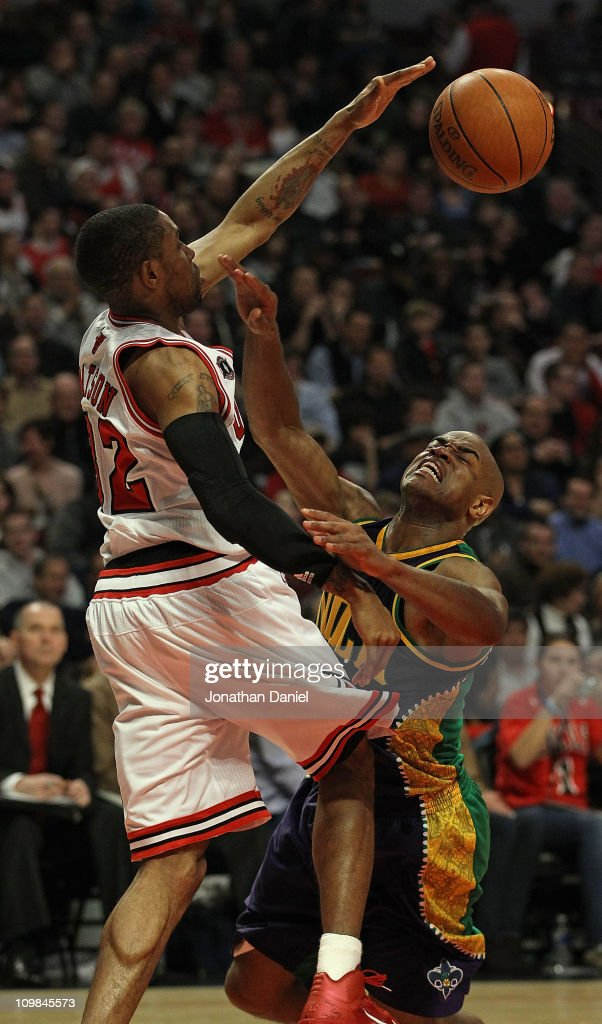 J Watson of the Chicago Bulls blocks a shot by Jarrett Jack of the New Orleans Hornets but is called for a foul at the United Center on March 7 2011...