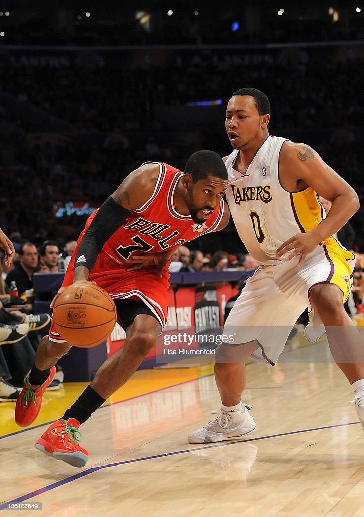J Watson of the Chicago Bulls drives against Andrew Goudelock of the Los Angeles Lakers at Staples Center on December 25 2011 in Los Angeles...