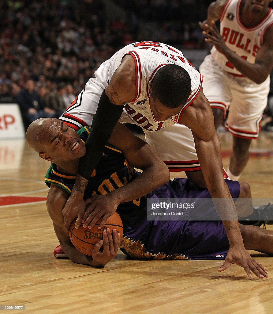 J Watson of the Chicago Bulls tries to grab the ball from Jarrett Jack of the New Orleans Hornets and forces a jump ball at the United Center on...