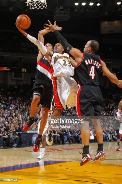 J Watson of the Golden State Warriors slashes to the hoop against Jerryd Bayless and Nicolas Batum of the Portland Trail Blazers on March 11 2010 at...