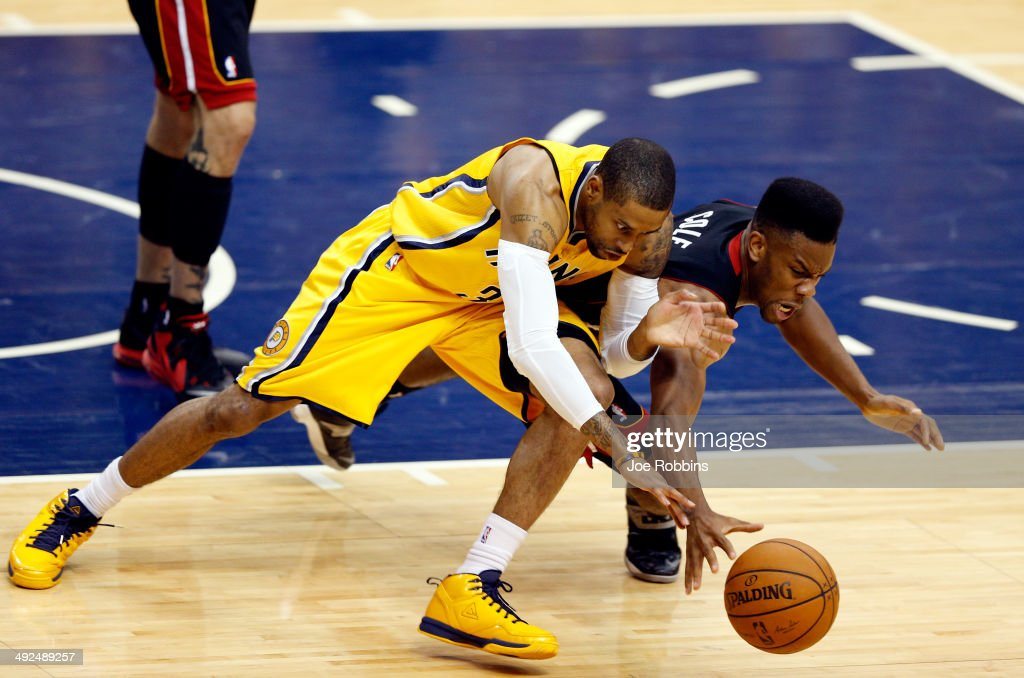 C.J. Watson #32 of the Indiana Pacers and Norris Cole #30 of the Miami Heat battle for a loose ball during Game Two of the Eastern Conference Finals of the 2014 NBA Playoffs at at Bankers Life Fieldhouse on May 20, 2014 in Indianapolis, Indiana.