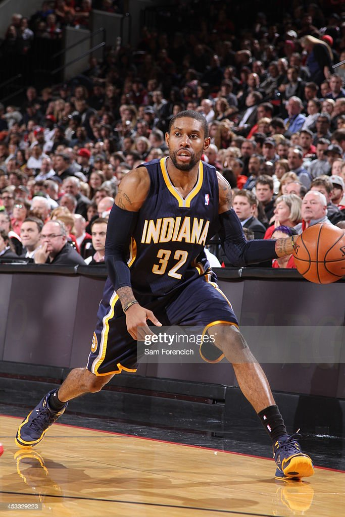 J Watson of the Indiana Pacers dribbles the ball against the Portland Trail Blazers on December 2 2013 at the Moda Center Arena in Portland Oregon...
