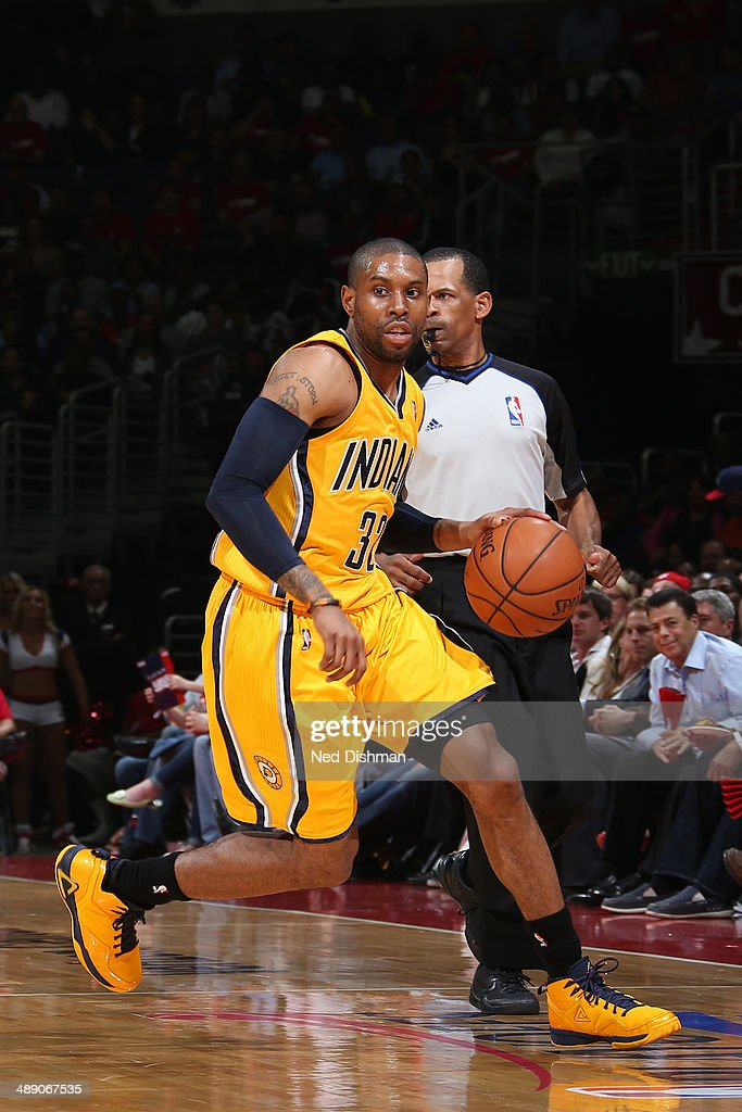 J Watson of the Indiana Pacers dribbles up the court against the Washington Wizards in Game Three of the Eastern Conference SemiFinals during the...