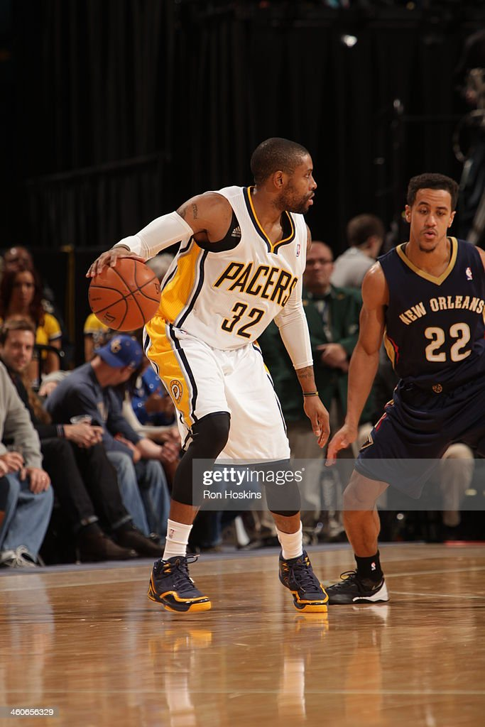 J Watson of the Indiana Pacers dribbles up the court against the New Orleans Pelicans at Bankers Life Fieldhouse on January 4 2014 in Indianapolis...