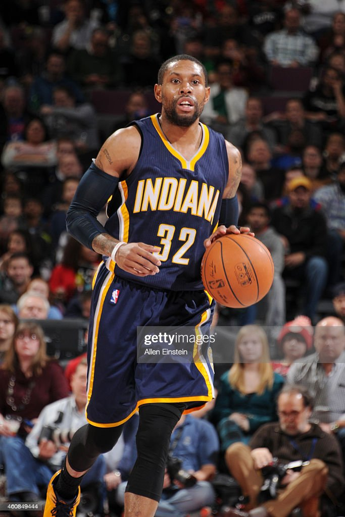 J Watson of the Indiana Pacers dribbles up the court agaisnt the Detroit Pistons during the game on December 26 2014 at The Palace of Auburn Hills in...