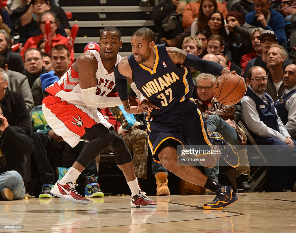 CJ Watson of the Indiana Pacers drives against the Toronto Raptors on January 1 2014 at the Air Canada Centre in Toronto Ontario Canada NOTE TO USER...