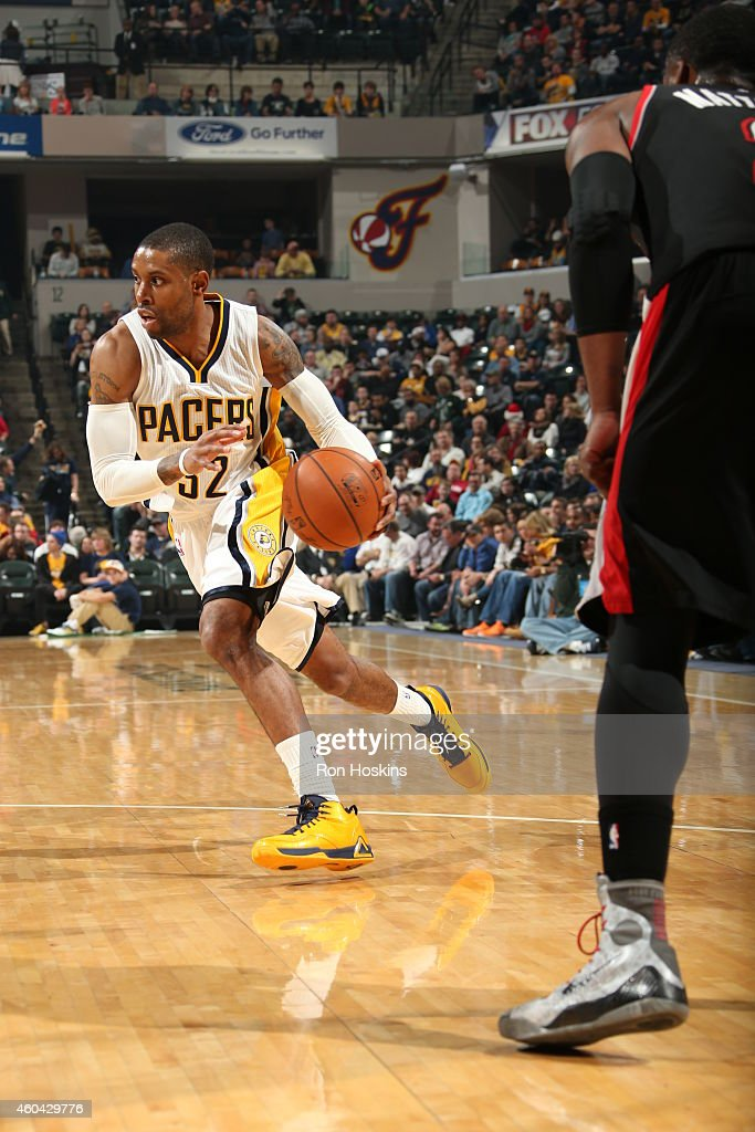 J Watson of the Indiana Pacers drives to the basket against the Portland Trail Blazers on December 13 2014 at Bankers Life Fieldhouse in Indianapolis...