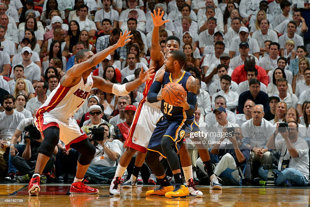 J Watson of the Indiana Pacers handles the ball against Chris Bosh and Norris Cole of the Miami Heat in Game Four of the Eastern Conference...
