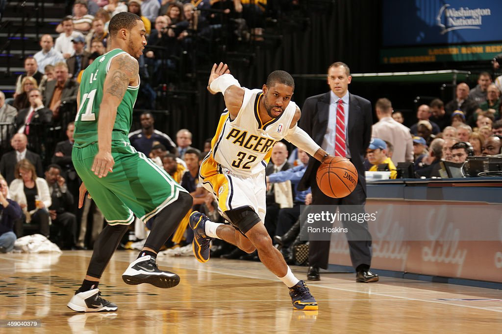 C.J. Watson #32 of the Indiana Pacers handles the ball against the Boston Celtics on December 22, 2013 in Indianapolis, Indiana at Bankers Life Fieldhouse.
