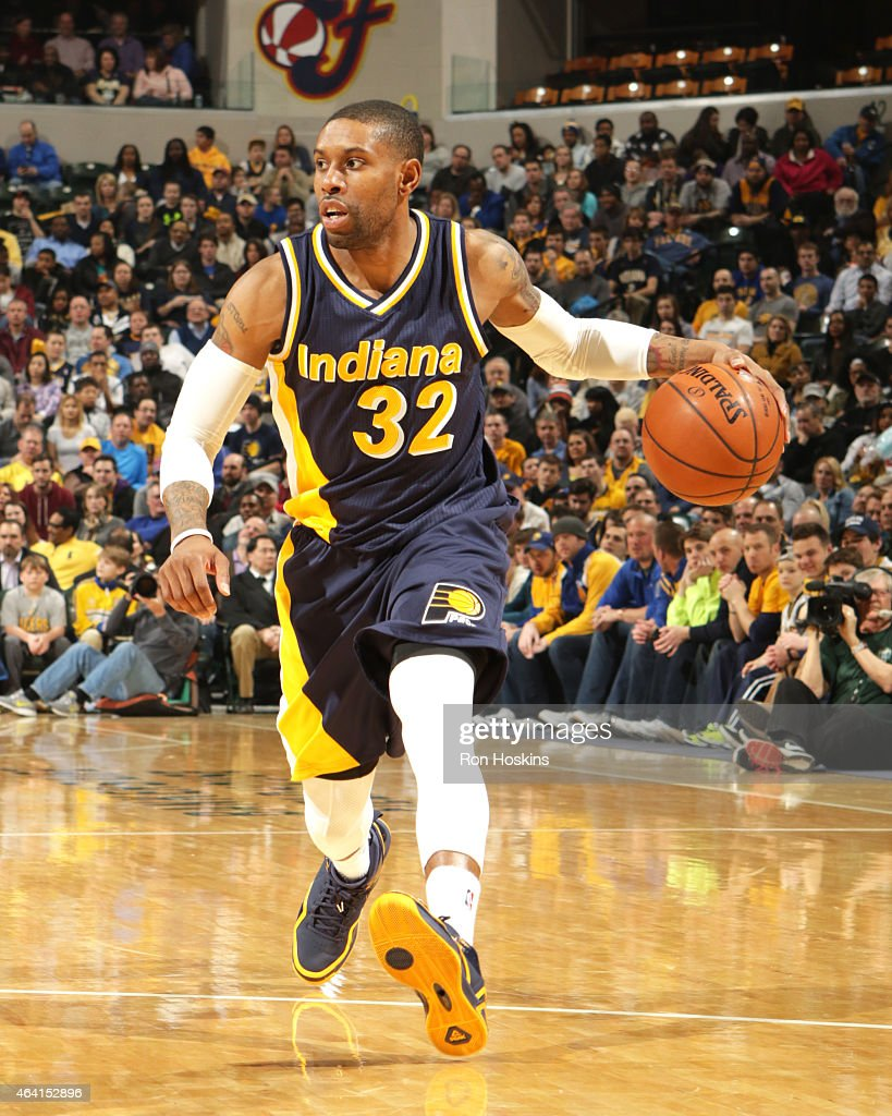 J Watson of the Indiana Pacers handles the ball against the Golden State Warriors on February 22 2015 at Bankers Life Fieldhouse in Indianapolis...