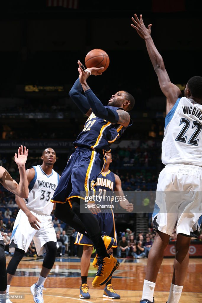 J Watson of the Indiana Pacers shoots against the Minnesota Timberwolves on December 21 2014 at Target Center in Minneapolis Minnesota NOTE TO USER...