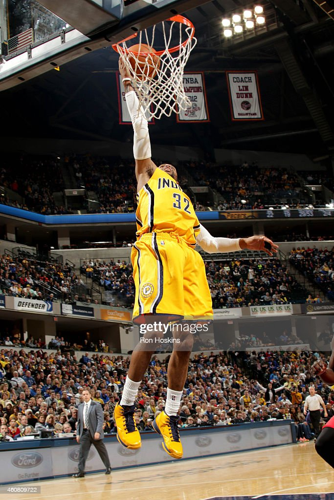 J Watson of the Indiana Pacers shoots against the New Orleans Pelicans on December 23 2014 at Bankers Life Fieldhouse in Indianapolis Indiana NOTE TO...
