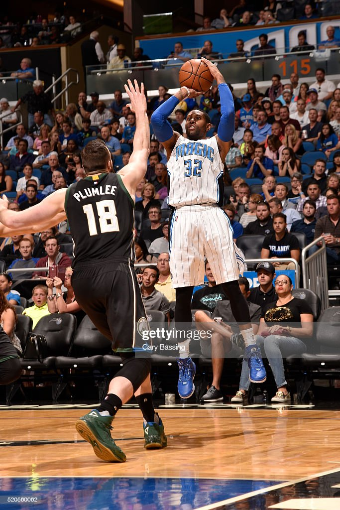 J Watson of the Orlando Magic shoots against Miles Plumlee of the Milwaukee Bucks during the game on April 11 2016 at Amway Center in Orlando Florida...