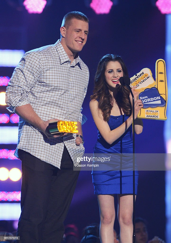 J.J. Watt and Laura Marano speak onstage at the Third Annual Hall of Game Awards hosted by Cartoon Network at Barker Hangar on February 9, 2013 in Santa Monica, California. 23270_003_JK_0846.JPG